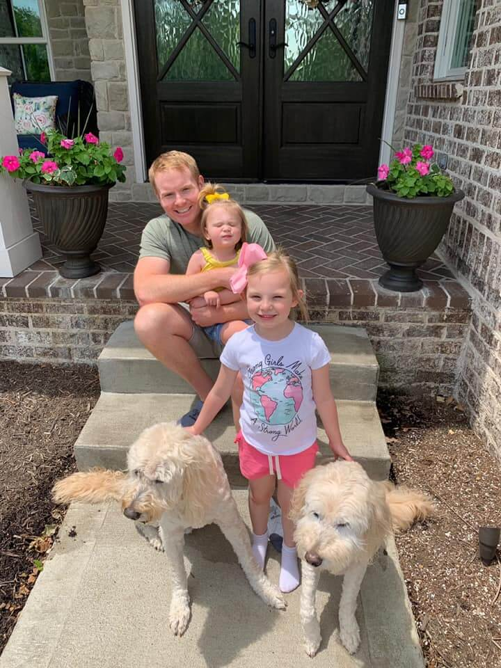 Dr. Kevin Smith with his daughter's and two dogs